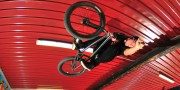 BMX flying under roof top