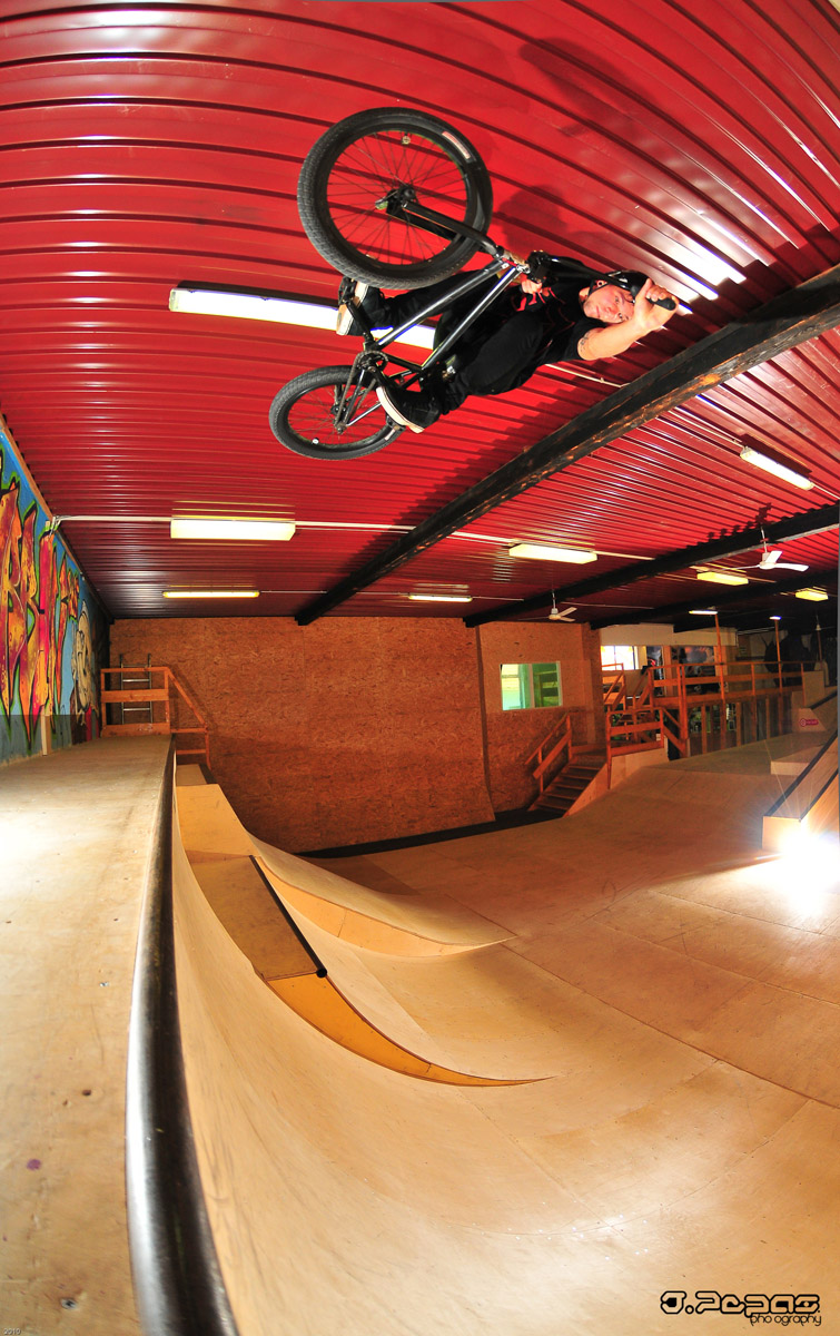 Daily Photo: BMX Flying Under Roof Top