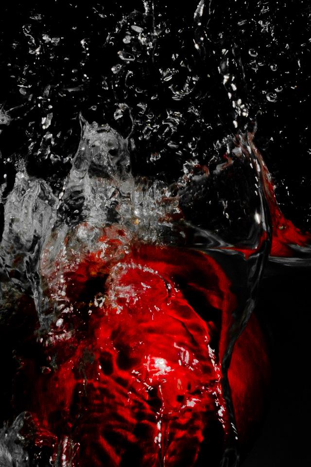 Pomegranate splash of-water iphone wallpaper