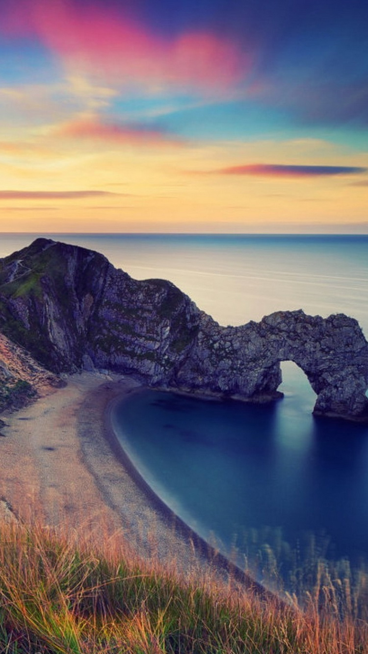 Stunning Sunset At Durdle Door Beach Wallpaper For IPhone 6.